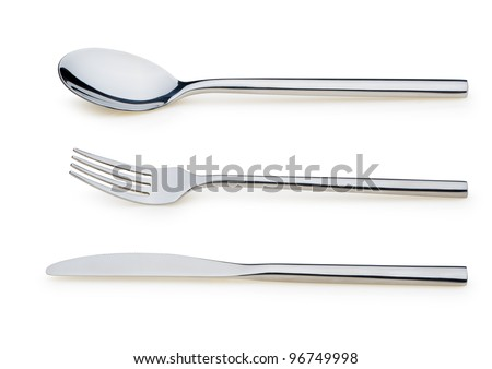 Spoon, fork and a knife. It is isolated on a white background - stock photo