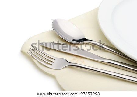Spoon, fork and a knife lie on serviette. It is isolated on a white background - stock photo