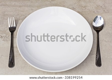 spoon, fork and empty dish on a tile surface - Empty Dish  (ready for your design) - stock photo