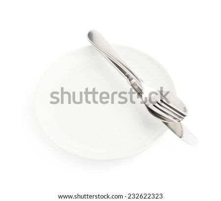 Spoon, fork and knife over the empty white plate, composition isolated over the white background