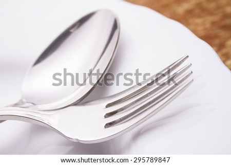 spoon fork and plate set on the table