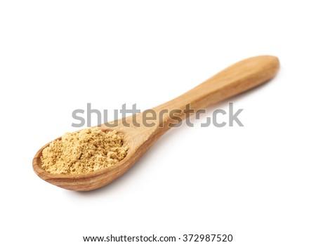 Spoon full of ginger powder - stock photo