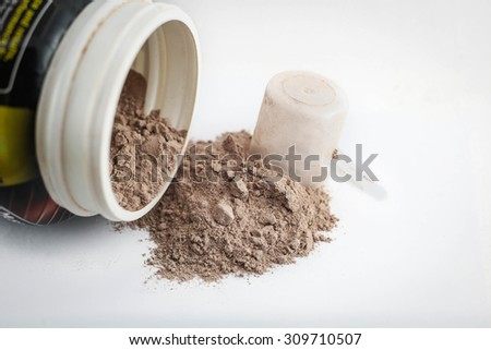 Spoon measure Whey protein chocolate powder for fitness and bodybuilding gaining muscle.