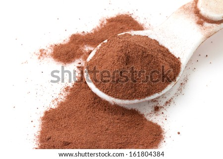 Spoon of cocoa on white - stock photo