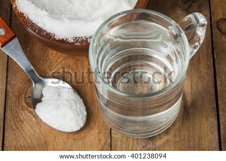 Spoon of salt, sugar, soda with glass of water