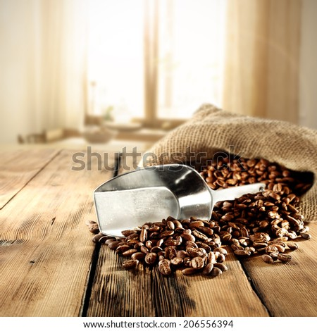 spoon of silver and coffee beans  - stock photo
