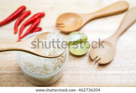 Spoon up the jasmine rice with food ingredients background