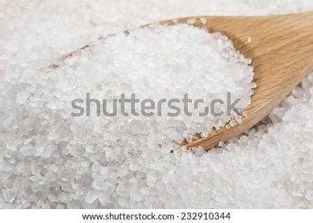 Spoon with sea salt - stock photo