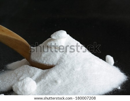 Spoonful of soda. Shallow depth of field. - stock photo