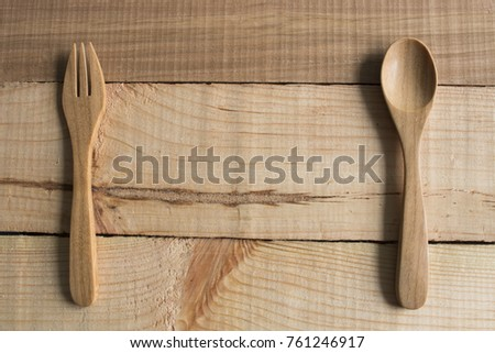 Spoons and fork on table, All is wooden for good health, copyspace for use