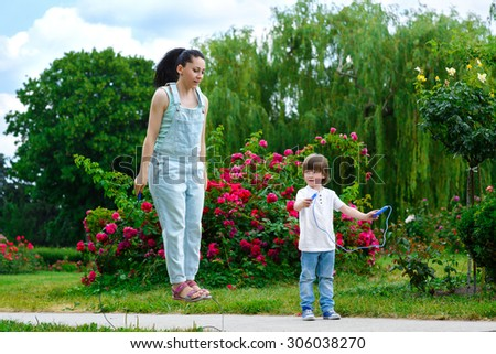 Sport activity lifestyle concept. Cute woman and son with skipping ropes
