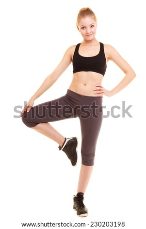 sport and active life. fitness sporty blonde girl young woman in sportswear stretching her leg isolated on white. - stock photo
