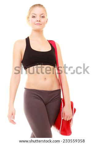 Sport and active lifestyle. Fitness sporty girl in sportswear with red gym bag isolated on white.