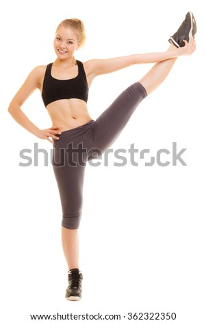 Sport and active lifestyle. Sporty flexible girl fitness woman in sportswear doing stretching exercise isolated on white. - stock photo