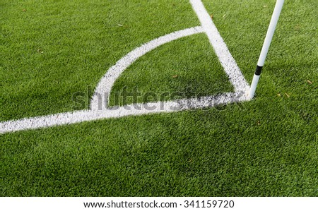 sport and game concept - close up of football field corner with marker - stock photo