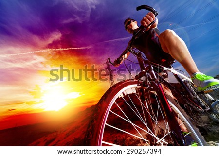 Sport and healthy life.Mountain bike and sunset. - stock photo