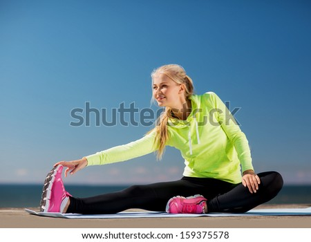 sport and lifestyle concept - woman doing sports outdoors