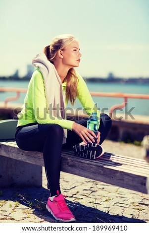 sport and lifestyle concept - woman resting after doing sports outdoors - stock photo