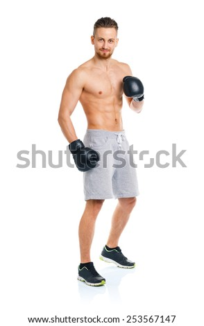 Sport attractive man wearing boxing gloves on the white background