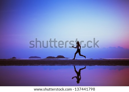 sport background, run to purpose, woman silhouette on the beach