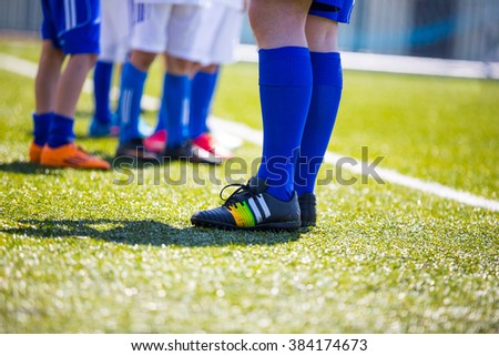 Sport background. Soccer team; Boys With Football Coach at a Training Field