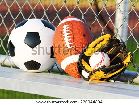 Sport balls. Soccer ball, american football and baseball in yellow glove. Outdoors - stock photo