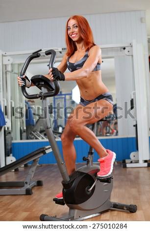 sport biking in the gym  - stock photo