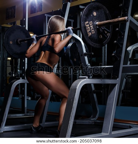 Sport, bodybuilding. Attractive woman in the gym - stock photo
