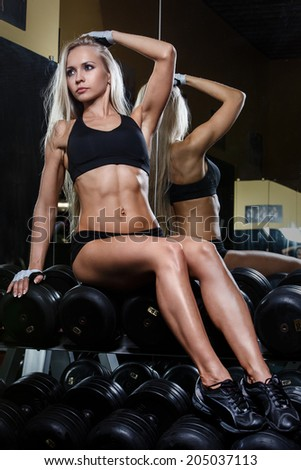 Sport, bodybuilding. Attractive woman in the gym