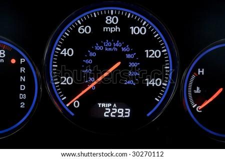 Sport car speedometer isolated on black - stock photo
