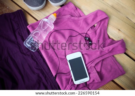 Sport clothes, shoes and headphones - stock photo