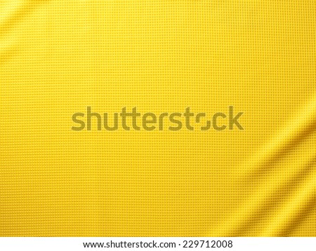 Sport Clothing Fabric Texture Background. Top View of Cloth Textile Surface. Yellow Football Shirt. Text Space - stock photo
