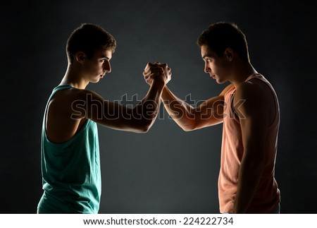 sport, competition, strength and people concept - young men wrestling - stock photo