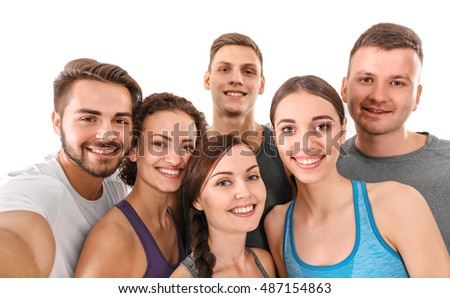 Sport concept. Group of people taking selfie in gym