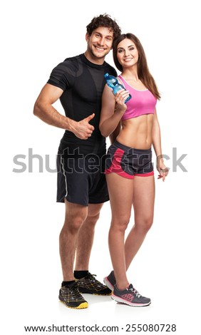 Sport couple - man and woman with bottle of water on the white background - stock photo