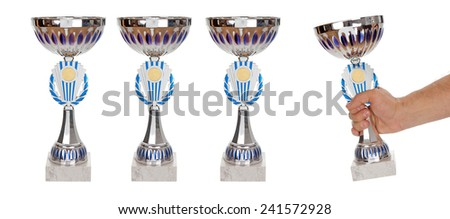 Sport cup taking by hand from the line of trophies isolated over white - stock photo