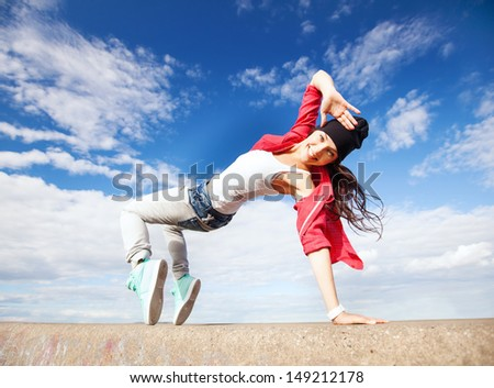 sport, dancing and urban culture concept - beautiful dancing girl in movement - stock photo