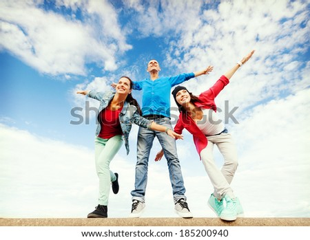 sport, dancing and urban culture concept - group of teenagers spreading hands - stock photo