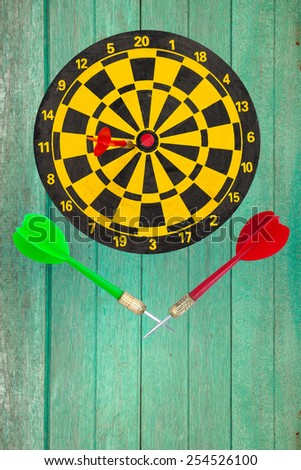 Sport Dart go to target and success on green wood wall background