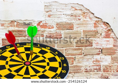 Sport Dart go to target and success on old brick wall background