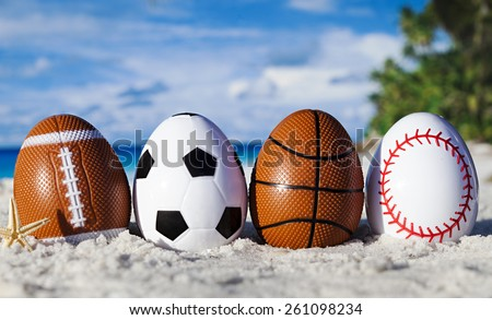 Sport eggs on ocean beach â??easter symbol