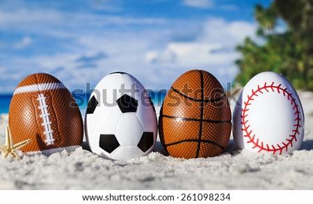 Sport eggs on ocean beach â??easter symbol - stock photo