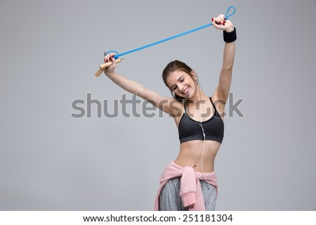 sport, exercise and healthcare - sporty woman with skipping rope - stock photo
