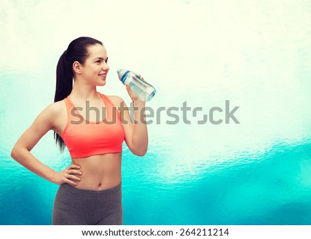 sport, exercise and healthcare - sporty woman with water bottle - stock photo