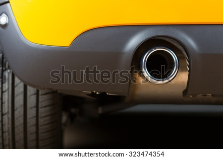 Sport exhaust in a car stopped orange - stock photo