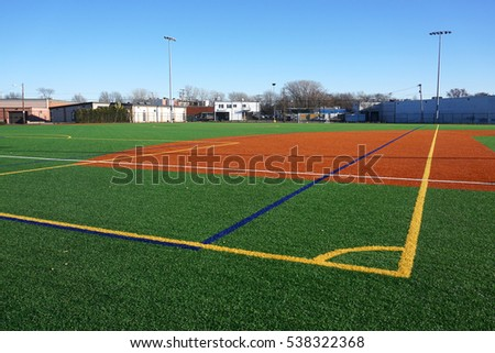sport field in residential area with artificial green grass