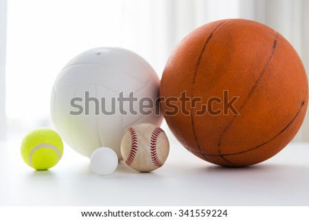 sport, fitness, game and objects concept - close up of different sports balls set - stock photo