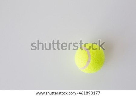 sport, fitness, game, sports equipment and objects concept - close up of tennis ball over white background from top