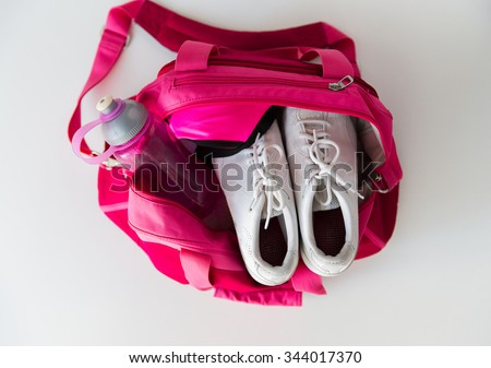 sport, fitness, healthy lifestyle and objects concept - close up of female sports stuff in backpack and dumbbells - stock photo