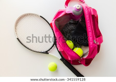 sport, fitness, healthy lifestyle and objects concept - close up of tennis racket and balls with female sports bag - stock photo